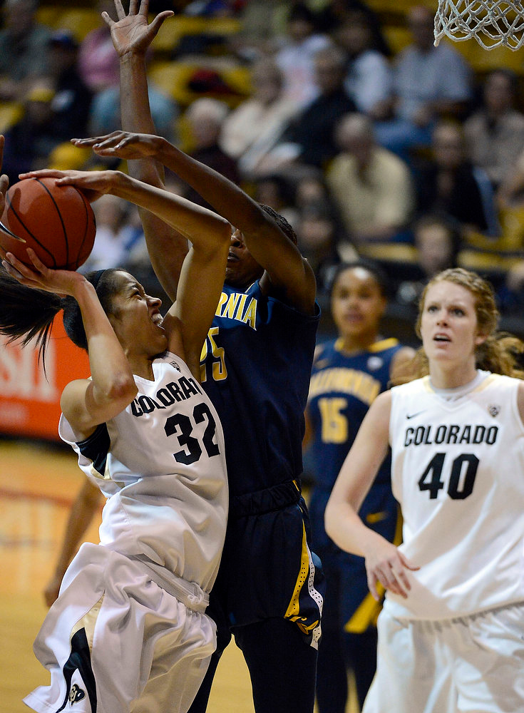 . Colorado Buffaloes forward Arielle Roberson (32) goes up for a shot on California Golden Bears forward Gennifer Brandon (25) during the second half Sunday, January 6, 2013 at Coors Events Center. John Leyba, The Denver Post