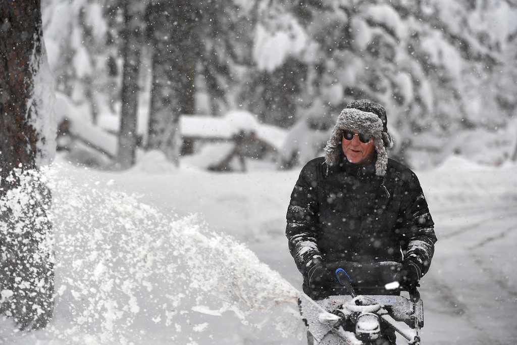. Robert Painter plows through almost 2 feet of snow in his driveway on April 16, 2016 in Nederland, Colorado. A spring storm dumped more than 2 feet of snow in the foothills and more is on the way.  (Photo by Helen H. Richardson/The Denver Post)