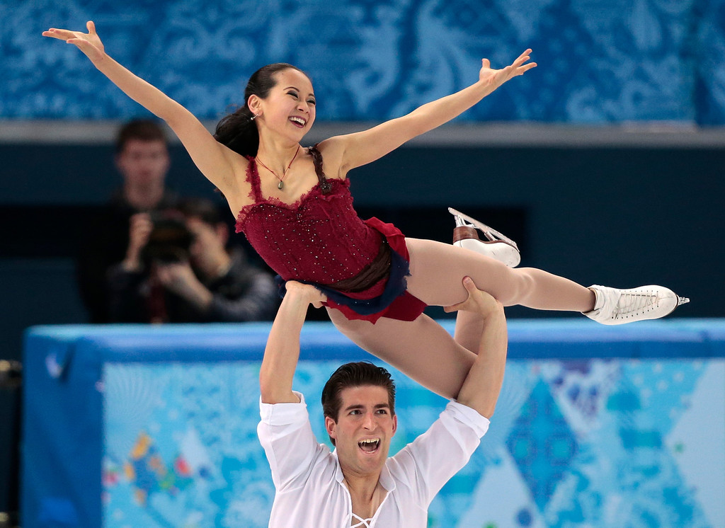 . Felicia Zhang and Nathan Bartholomay of the United States compete in the pairs free skate figure skating competition at the Iceberg Skating Palace during the 2014 Winter Olympics, Wednesday, Feb. 12, 2014, in Sochi, Russia. (AP Photo/Ivan Sekretarev)