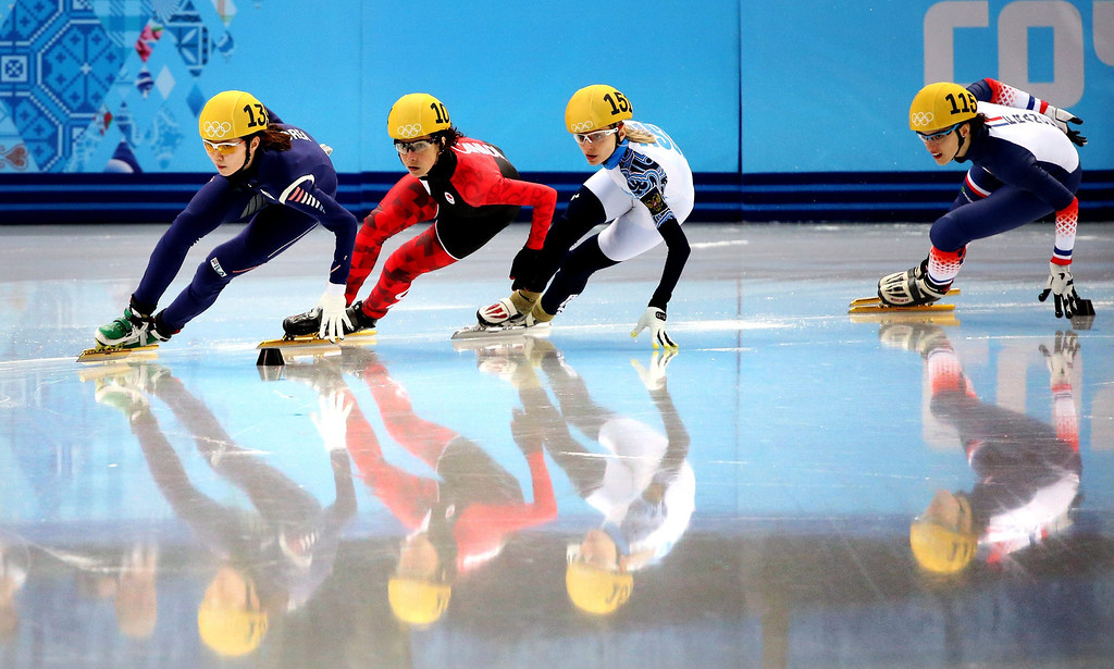 . (from left) Shim Suk Hee of Korea, Marie-Eve Drolet, Valeriya Reznik of Russia and Veronique Pierron of France compete in the Heat 1 in women\'s 500m at Short Track events in the Iceberg Skating Palace at the Sochi 2014 Olympic Games, Sochi, Russia, 15 February 2014.  EPA/Tatyana Zenkovich