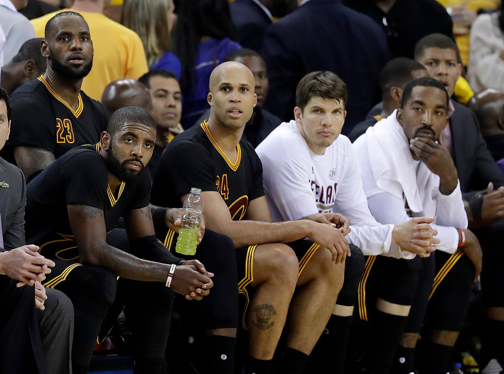 . Cleveland Cavaliers\' Kyrie Irving, seated from left, LeBron James, Richard Jefferson, Kyle Korver and J.R. Smith sit on the bench during the second half of Game 2 of basketball\'s NBA Finals against the Golden State Warriors in Oakland, Calif., Sunday, June 4, 2017. (AP Photo/Marcio Jose Sanchez)