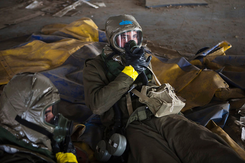 . Israeli soldiers, wearing protective gear, lie on the ground during a drill simulating a chemical attack in Azur, near Tel Aviv May 28, 2013. Israel continued on Tuesday with its annual home front defense exercise, launched on Monday, preparing soldiers and civilians for missile attacks. REUTERS/Nir Elias