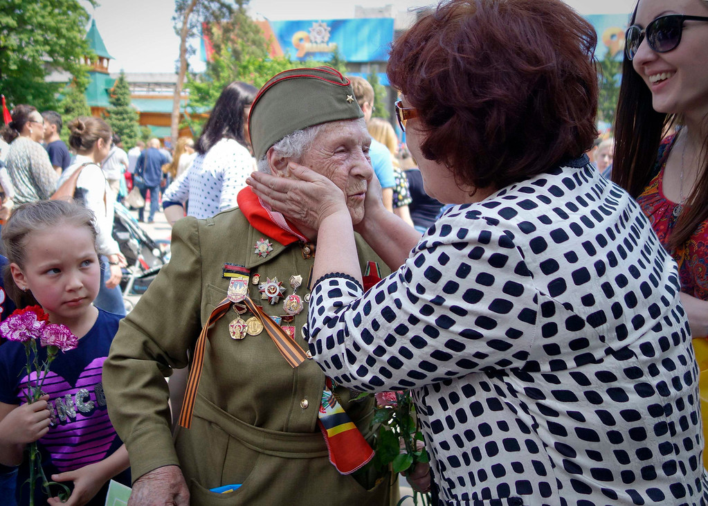 . A woman congratulates World War Two veteran Zinaida Efanova, 88, at a memorial during Victory Day celebrations in Almaty May 9, 2013.  REUTERS/Shamil Zhumatov