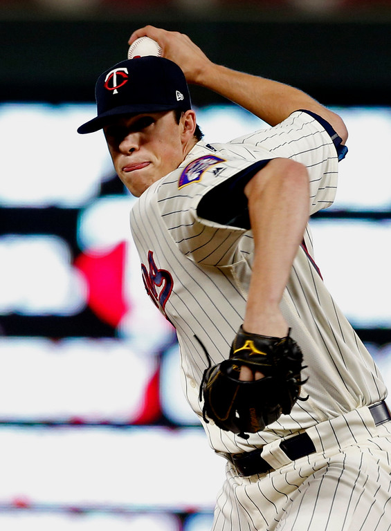 . Minnesota Twins pitcher Trevor Hildenberger throws to the Cleveland Indians during the seventh inning of the second game of a baseball doubleheader Thursday, Aug. 17, 2017, in Minneapolis. The Twins won 4-2. Hildenberger got the win. (AP Photo/Jim Mone)