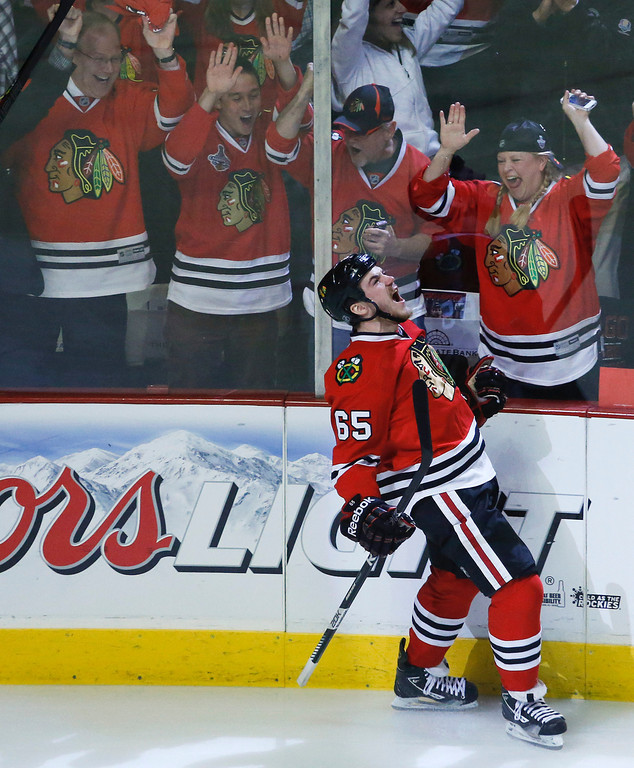 . Chicago Blackhawks center Andrew Shaw (65) reacts after scoring a goal against the Los Angeles Kings during the first period in Game 2 of the NHL hockey Stanley Cup Western Conference finals Sunday, June 2, 2013 in Chicago. (AP Photo/Charles Rex Arbogast)