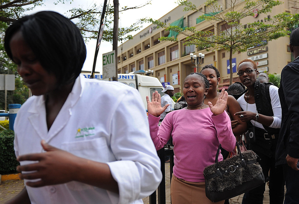 . A woman (2ndL) who had been held hostage reacts following a security operation at an upmarket shopping mall, where suspected terrorists engaged Kenyan security forces in a drawn out gun fight on September 21 2013 in Nairobi. Some 20 people have been killed and about 50 wounded Saturday in the initial attack by the gunmen the Kenya Red Cross said. AFP PHOTO/Tony  KARUMBA/AFP/Getty Images