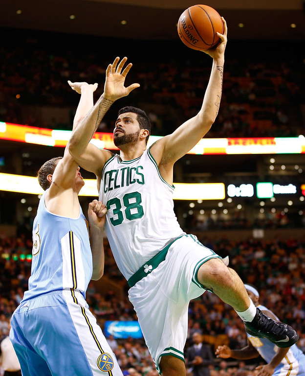 . BOSTON, MA - DECEMBER 06: Vitor Faverani #38 of the Boston Celtics goes up for a layup in front Timofey Mozgov #25 of the Denver Nuggets in the second quarter during the game at TD Garden on December 6, 2013 in Boston, Massachusetts.  (Photo by Jared Wickerham/Getty Images)