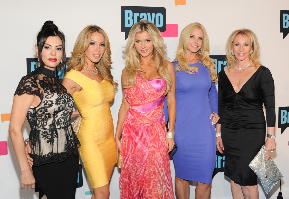 ". ""The Real Housewives of Miami\"" cast members, from left, Adriana De Moura, Lisa Hochstein, Joanna Krupa, Alexis Echevarria and Lea Black attend the Bravo Network 2013 Upfront on Wednesday April 3, 2013 in New York. (Photo by Evan Agostini/Invision/AP)"