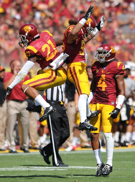 . USC #21 Su\'s Cravens #56 Anthony Sarao and #4 Torin Harris celebrate in the 3rd quarter. USC defeated Boston College 35-7 in a game played at the Coliseum in Los Angeles, CA. 9/14/2013. photo by (John McCoy/Los Angeles Daily News)