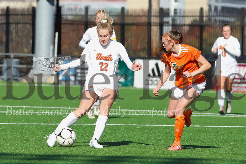 North Catholic's Jayden Sharpless dribbles past  Yough's Nicole Croushore in the second half of Saturday's WPIAL Class 2A Championship at Highmark Stadium in Pittsburgh. Sharpless scored the game winning goal late in double overtime to top the Cougars 1-0. Seb Foltz/Butler Eagle