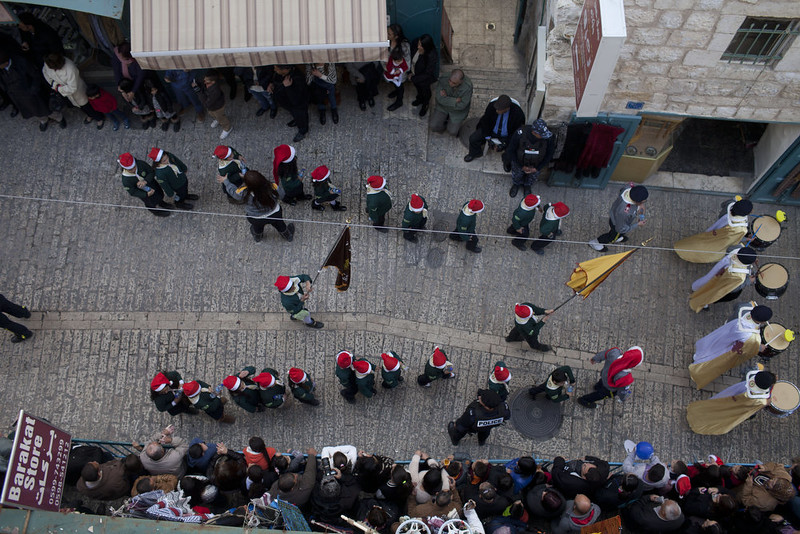 . Palestinian children parade outside the Church of the Nativity on December 24, 2014 in Bethlehem, West Bank. Every Christmas pilgrims travel to the church where a gold star embedded in the floor marks the spot where Jesus was believed to have been born.  (Photo by Lior Mizrahi/Getty Images)