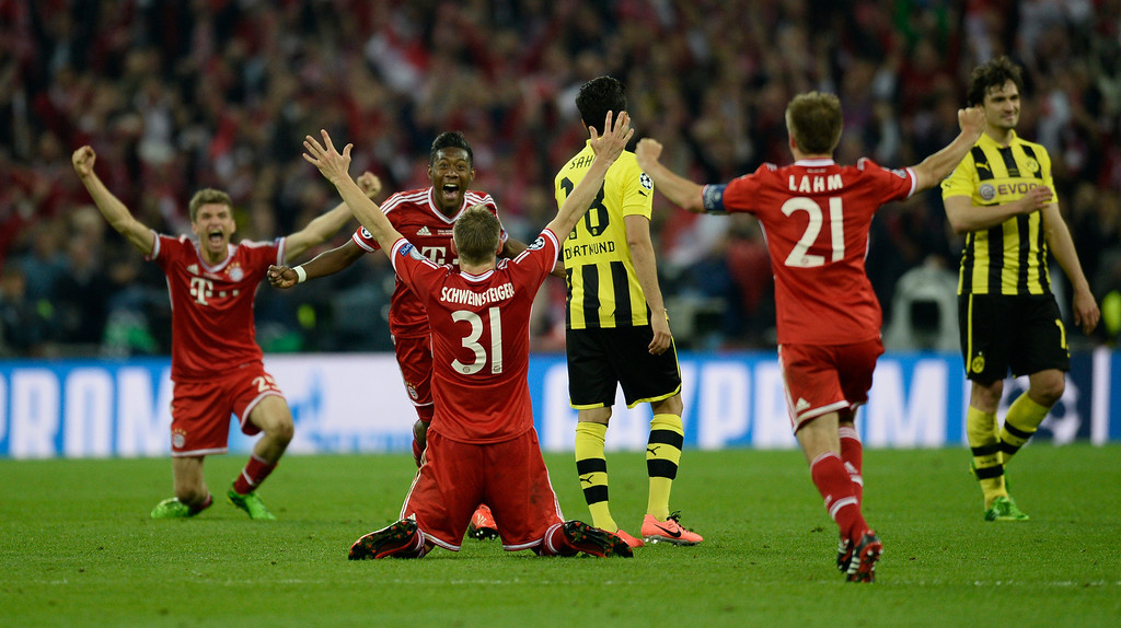 . Bayern Munich players celebrate at the final whistle after winning the UEFA Champions League final football match between Borussia Dortmund and Bayern Munich at Wembley Stadium in London on May 25, 2013. ADRIAN DENNIS/AFP/Getty Images