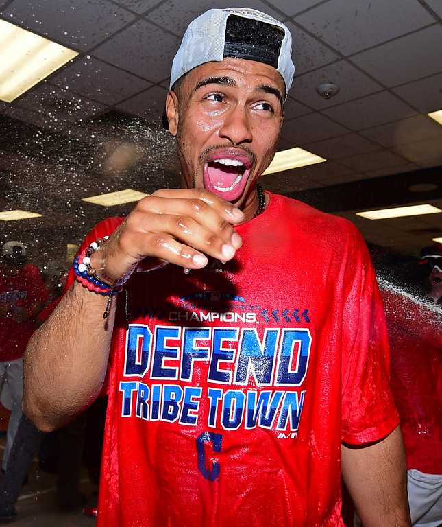 . Cleveland Indians Francisco Lindor celebrates in the clubhouse after the Indians defeated the Detroit Tigers 15-0 to clinch the American League Central Division, in a baseball game, Saturday, Sept.15, 2018, in Cleveland. (AP Photo/David Dermer)