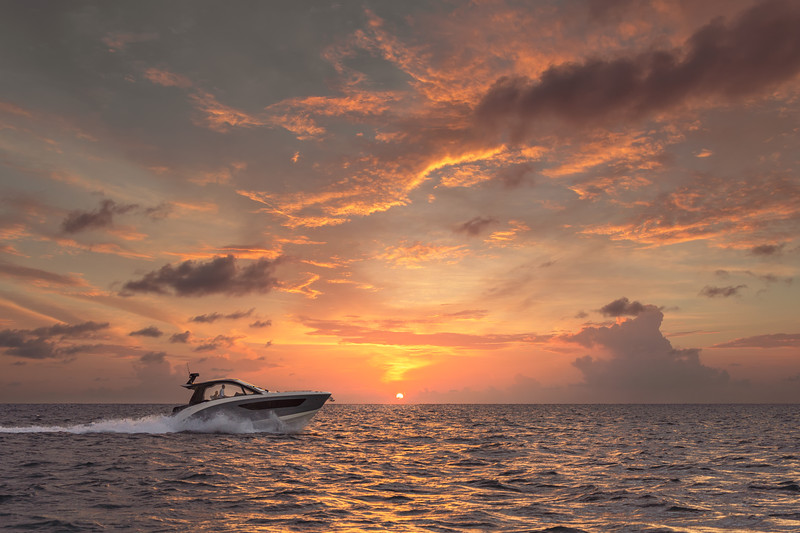 2021-Sundancer-370-Outboard-DAO370-lifestyle-starboard-profile-sunset-00702-select.jpg