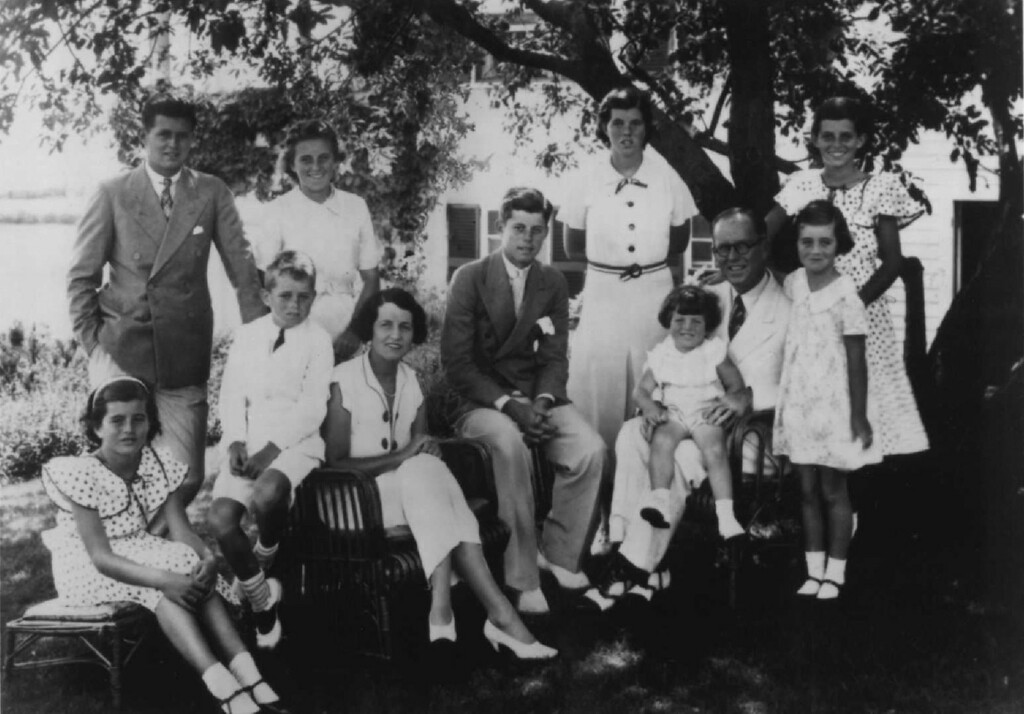 . The Kennedy family gathers for a photo in 1934. From left: Pat, Joe Jr., Bobby, Kathleen, Rose, Jack, Rosemary, Teddy, Joe Sr., Jean and Eurnice. Denver Post file