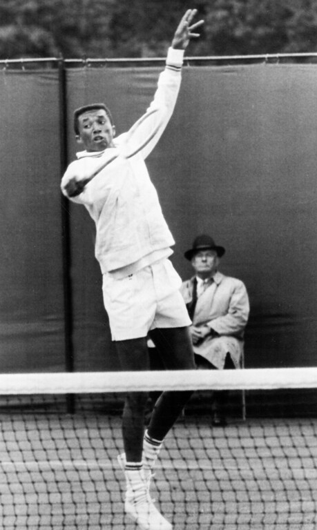 . Arthur Ashe, 22, American from Richmond, Va., competes in tennis championships at Wimbledon, England, June 23, 1965.  He defeated Pierre Darmon of France.  (AP Photo)