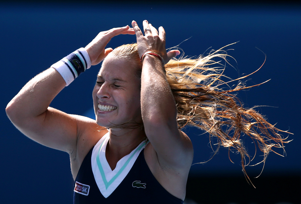. Dominika Cibulkova of Slovakia celebrates after defeating  Agnieszka Radwanska of Poland during their semifinal at the Australian Open tennis championship in Melbourne, Australia, Thursday, Jan. 23, 2014.(AP Photo/Aaron Favila)