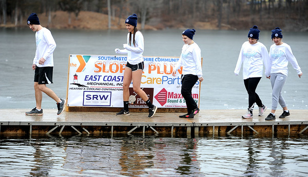 1/19/2019 Mike Orazzi | Staff Jumpers during the 14th annual Sloper Plunge at Camp Slopers pond Saturday in Southington.