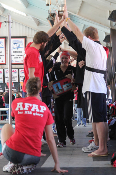 Team celebrates the seniors at the senior swim meet against College of Charleston