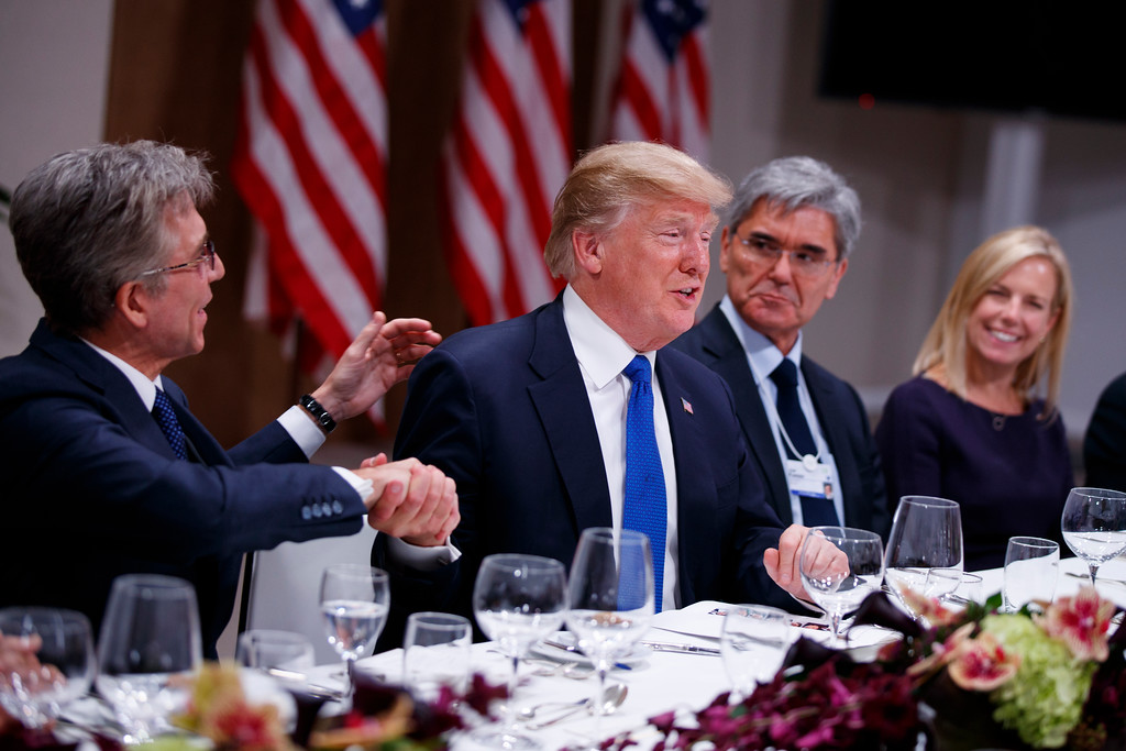 . President Donald Trump listens during a dinner with European business leaders at the World Economic Forum, Thursday, Jan. 25, 2018, in Davos. From left, SAP CEO Bill McDermott, Trump, CEO of Seimens Joe Kaeser, and Secretary of Homeland Security Kirstjen Nielsen. (AP Photo/Evan Vucci)