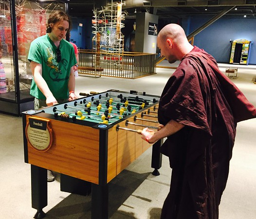 That monk plays a mean Foosball.