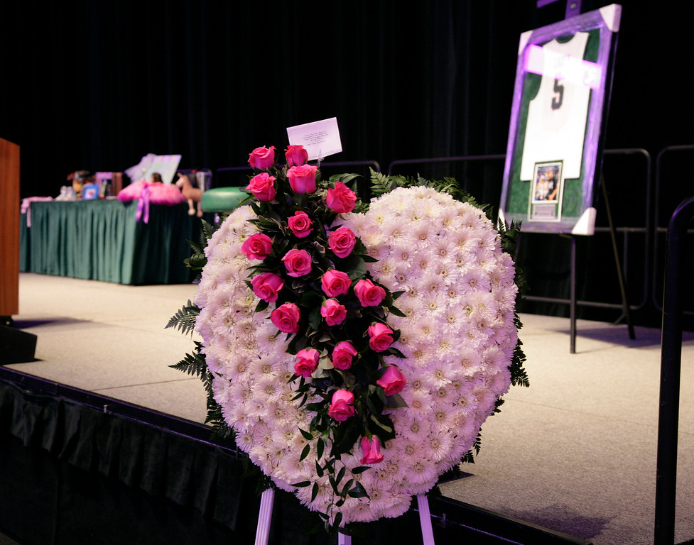 . Flowers and mementos adorn the stage before a memorial to celebrate the life and legacy of Lacey Holsworth, an 8-year-old Michigan State basketball fan whose battle with cancer inspired the team\'s players, coaches and many more beyond the hardwood, Thursday, April 17, 2014, at Michigan State University\'s Breslin Center in East Lansing, Mich. (AP Photo/Al Goldis)