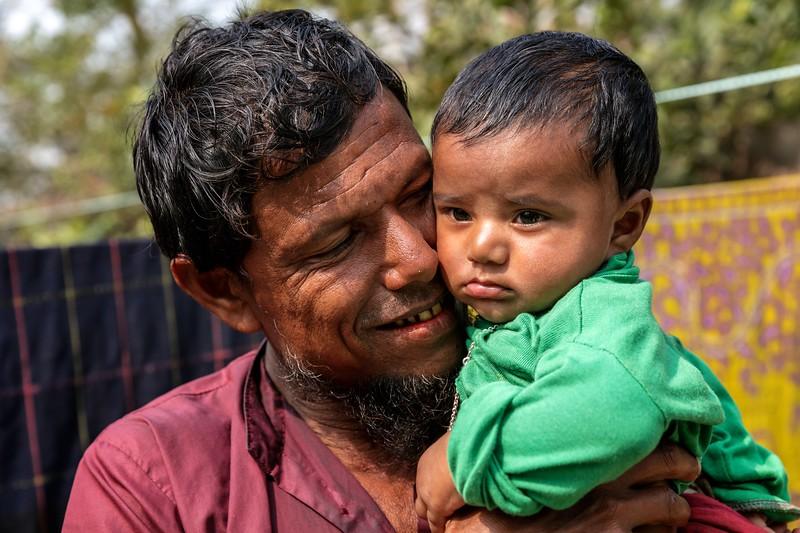 0025Nirob (4 months) & Zakir Sardar (Grandfather) Posing for photographs in front of the Courtyard.Hoglabunia Village, Dakua Union, Golachipa upazilla, Patuakhali district. Bangladesh.Photo Credit: b.a.sujaN / Map / WRA