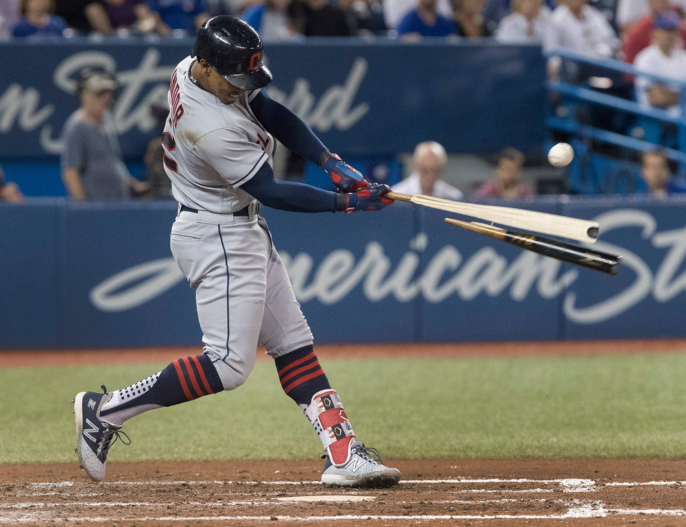 . Cleveland Indians\' Francisco Lindor hits a broken-bat single to drive in two runs against the Toronto Blue Jays during the fifth inning of a baseball game Thursday, Sept. 6, 2018, in Toronto. (Fred Thornhill/The Canadian Press via AP)