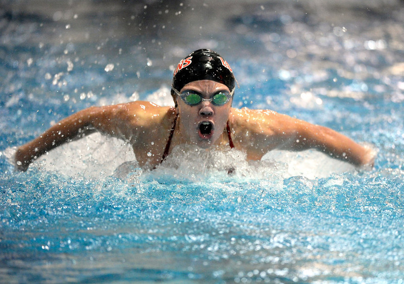 . Loveland High School sophomore Brooke Hansen came up for air during her performance in the Women\'s 100-Yard Butterfly race Saturday night. The Colorado Coaches Invitational Swimming and Diving Meet wrapped up Saturday night, December 15, 2012.  Karl Gehring/The Denver Post