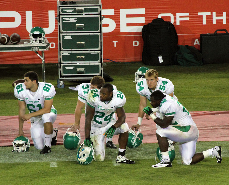 UNT players praying for a hurt player