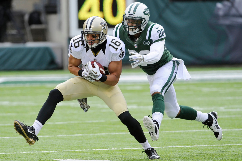 . New York Jets cornerback Kyle Wilson (20) tackles New Orleans Saints\' Lance Moore (16) during the first half of an NFL football game Sunday, Nov. 3, 2013, in East Rutherford, N.J.  (AP Photo/Bill Kostroun)