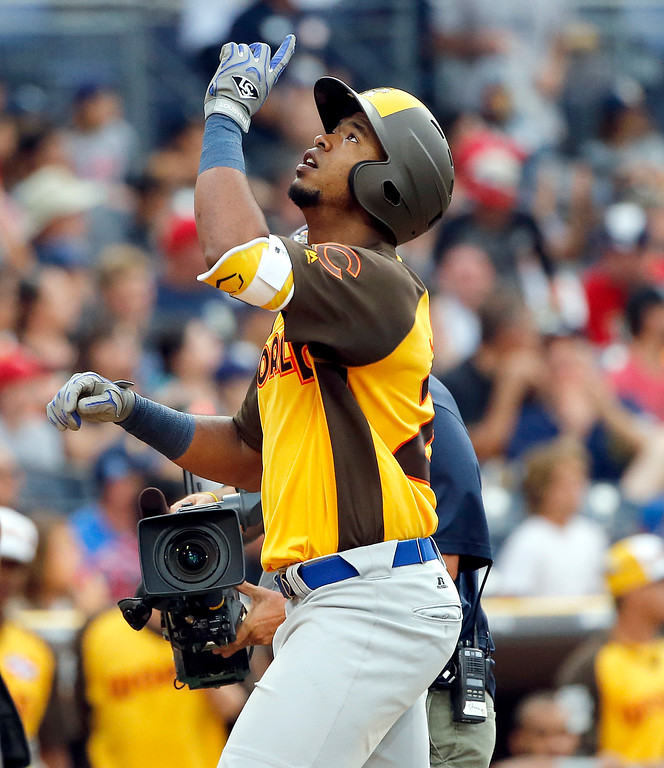 . World Team\'s Eloy Jimenez, of the Chicago Cubs, points after hitting a three run home run against the U.S. Team during the ninth inning of the All-Star Futures baseball game, Sunday, July 10, 2016, in San Diego. (AP Photo/Lenny Ignelzi)