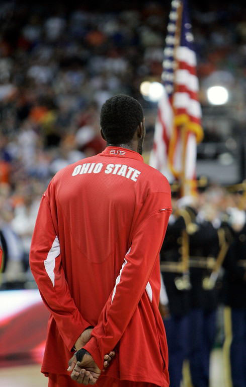 . Ohio State center Greg Oden (20) listens to the national anthem before  their men\'s championship basketball game against Florida at the Final Four in the Georgia Dome in Atlanta Monday, April 2, 2007. (AP Photo/Mark Humphrey)