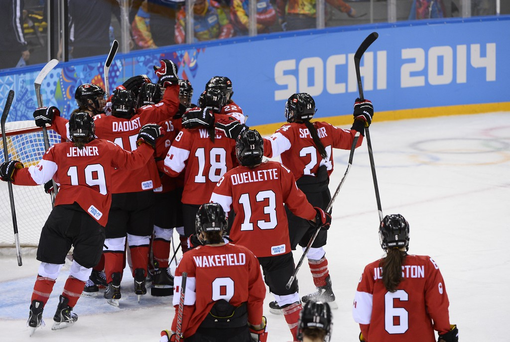 . Canada\'s players celebrate their victory in the Women\'s Ice Hockey Group A match between Canada and USA at the Sochi Winter Olympics on February 12, 2014 at the Shayba Arena. AFP PHOTO / JONATHAN NACKSTRAND/AFP/Getty Images