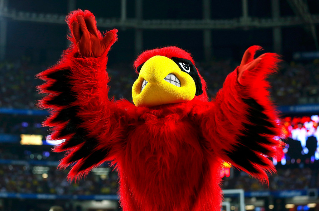 . The Louisville Cardinals mascot performe during the first half of the NCAA men\'s Final Four championship basketball game against the Michigan Wolverines in Atlanta, Georgia April 8, 2013. REUTERS/Chris Keane