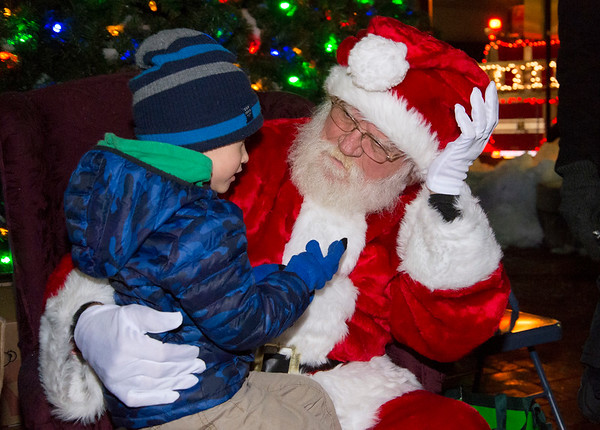 12/05/19 Wesley Bunnell | StaffrrThe New Britain Christmas tree was lit on Thursday night in Central Park complete with a visit from Santa Clause who rode in on a NBFD fire truck. James Ciccarillo, age 3, who helped light the tree discusses his gift wishes with Santa.