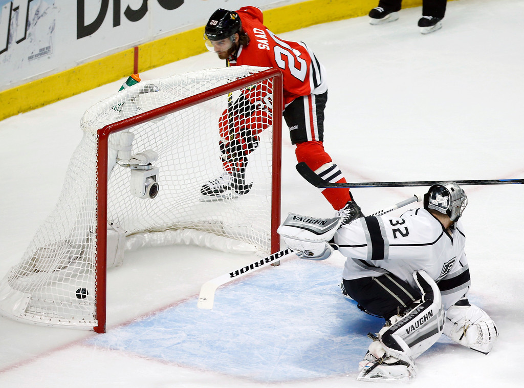 . Chicago Blackhawks left wing Brandon Saad (20) shoots a goal past Los Angeles Kings goalie Jonathan Quick (32) during the first period in Game 5 of the Western Conference finals in the NHL hockey Stanley Cup playoffs Wednesday, May 28, 2014, in Chicago. (AP Photo/Andrew A. Nelles)