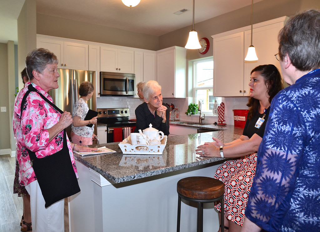 . Guests view the kitchen in one of the model cottages at Notre Dame Village. Submitted