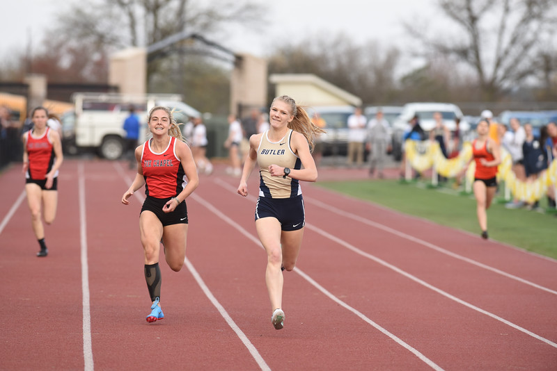 Butler's Liz Sims pushes down the final stretch of the 400m Thursday at the Butler Invitational. Seb Foltz/Butler Eagle.