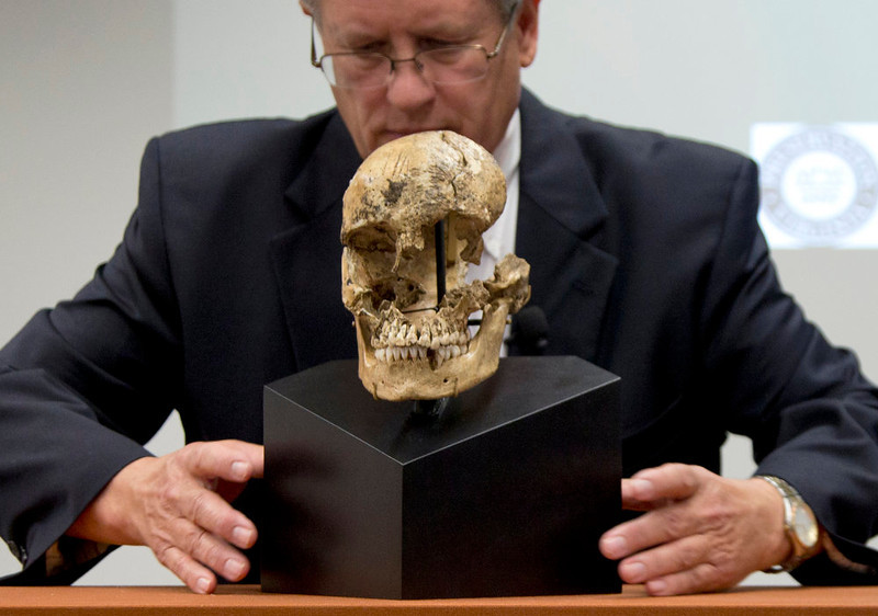 """. Doug Owsley, division head for Physical Anthropology at the Smithsonian\'s National Museum of Natural History, displays the skull of  \""""Jane of Jamestown\"""" during a news conference at the museum in Washington, Wednesday, May 1, 2013.  Scientists announced during the news conference that they have found the first solid archaeological evidence that some of the earliest American colonists at Jamestown, Va., survived harsh conditions by turning to cannibalism presenting the discovery of the bones of a 14-year-old girl, \""""Jane\"""" that show clear signs that she was cannibalized. (AP Photo/Carolyn Kaster)"""