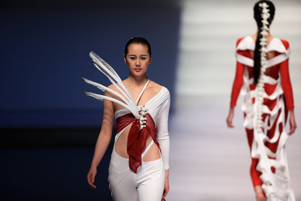 . Models showcase designs on the catwalk during Hempel Award the 21st China International Young Fashion Designers Contest  on the second day of Mercedes-Benz China Fashion Week Autumn/Winter 2013/2014  at Banquet Hall of Beijing Hotel on March 25, 2013 in Beijing, China.  (Photo by Feng Li/Getty Images)