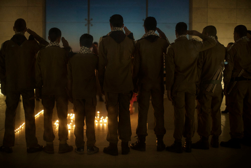 . Palestinian scouts salute at the mausoleum of the late leader Yasser Arafat in the West Bank city of Ramallah, on November 10, 2012, ahead of a ceremony marking the eighth anniversary of this death. The Palestinians\' most explosive secret may be lurking under the stone slab covering Arafat\'s tomb where experts hope to explain his mysterious death eight years ago. MARCO LONGARI/AFP/Getty Images