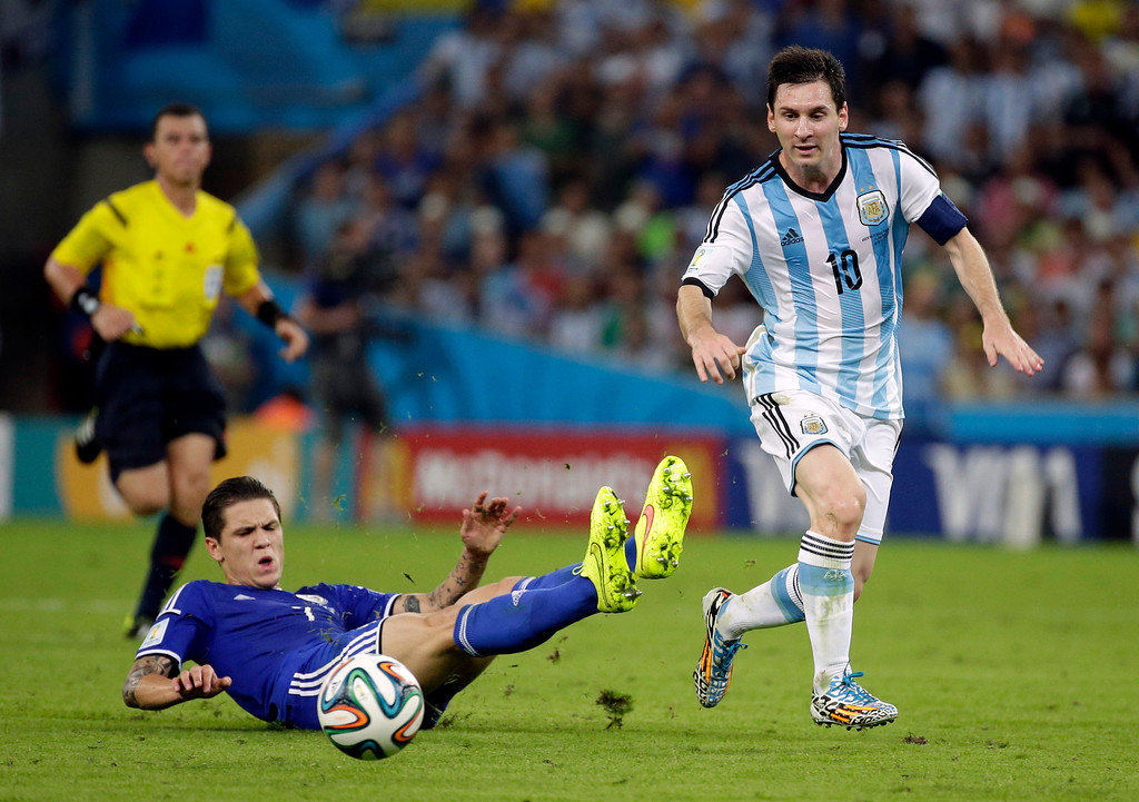. Argentina\'s Lionel Messi makes a run during the group F World Cup soccer match between Argentina and Bosnia at the Maracana Stadium in Rio de Janeiro, Brazil, Sunday, June 15, 2014.  (AP Photo/Felipe Dana)