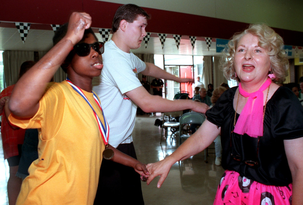 . Rochelle Hopkins, of Lake Orion, (left), Chris LeMonde, of Pontiac, (middle) and Pontiac Schools Music Therapist Margaret Hull (right) dance to oldies at the Kennedy Center dance which was part of the Kennedy Center Dream Cruise.