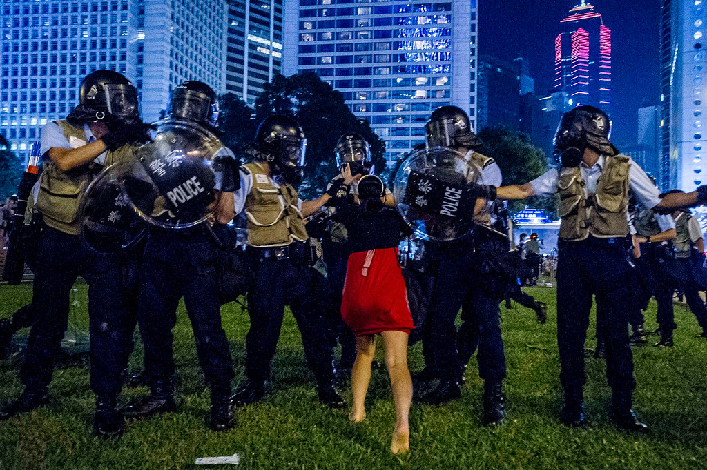 . A pro-democracy protester confronts the police during a demonstration in Hong Kong on September 28, 2014. Police fired tear gas as tens of thousands of pro-democracy demonstrators brought parts of central Hong Kong to a standstill on September 28, in a dramatic escalation of protests that have gripped the semi-autonomous Chinese city for days. It marked a dramatic escalation of protests in the city, which rarely sees such violence, after a tense week of largely contained student-led demonstrations exploded into mass angry street protests.  AFP PHOTO / XAUME OLLEROSXAUME OLLEROS/AFP/Getty Images