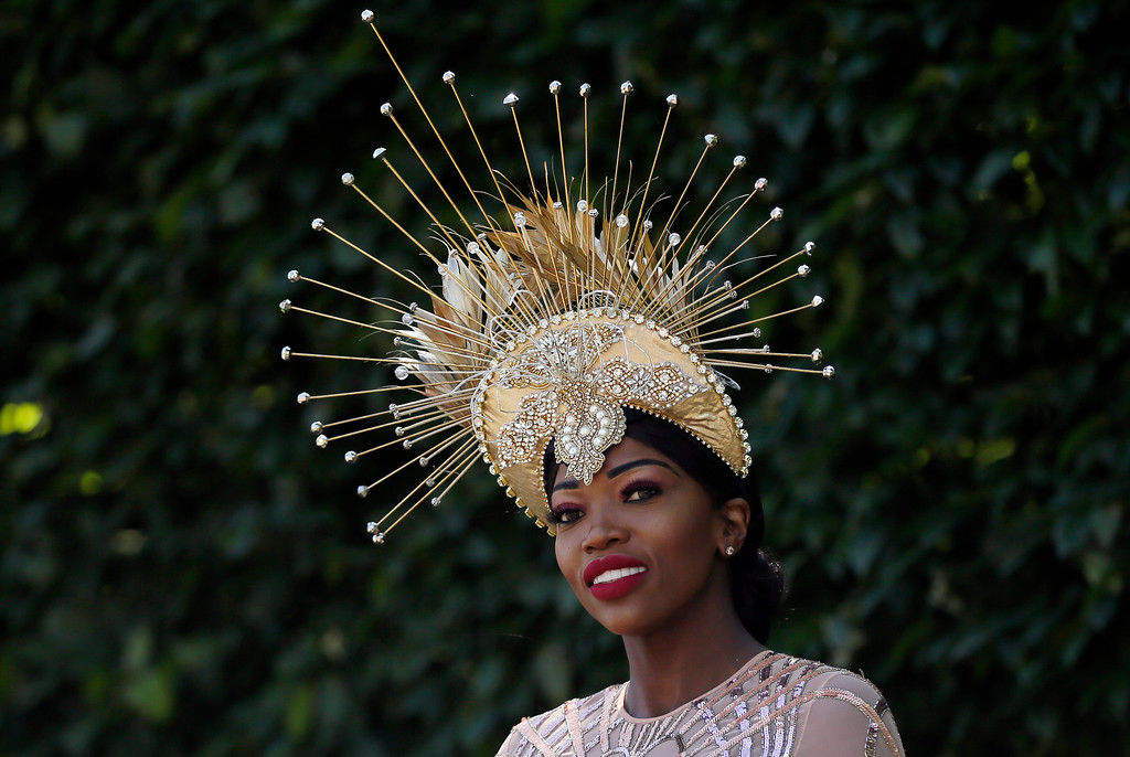 . A racegoer attends the third day of the Royal Ascot horse race meeting, which is traditionally known as Ladies Day, in Ascot, England Thursday, June 21, 2018. (AP Photo/Tim Ireland)