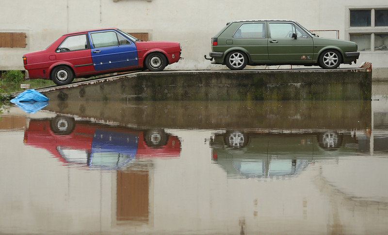 . Two cars stand among floodwaters from the nearby Weisse Elster river in the city center on June 3, 2013 in Zeitz, Germany. Heavy rains are pounding southern and eastern Germany, causing wide-spread flooding and ruining crops. At least two people are missing and feared dead in what is evolving into the most serious flood levels since the so-called 100-year flood of 2002. Portions of Austria and the Czech Republic are also inundated.  (Photo by Sean Gallup/Getty Images)