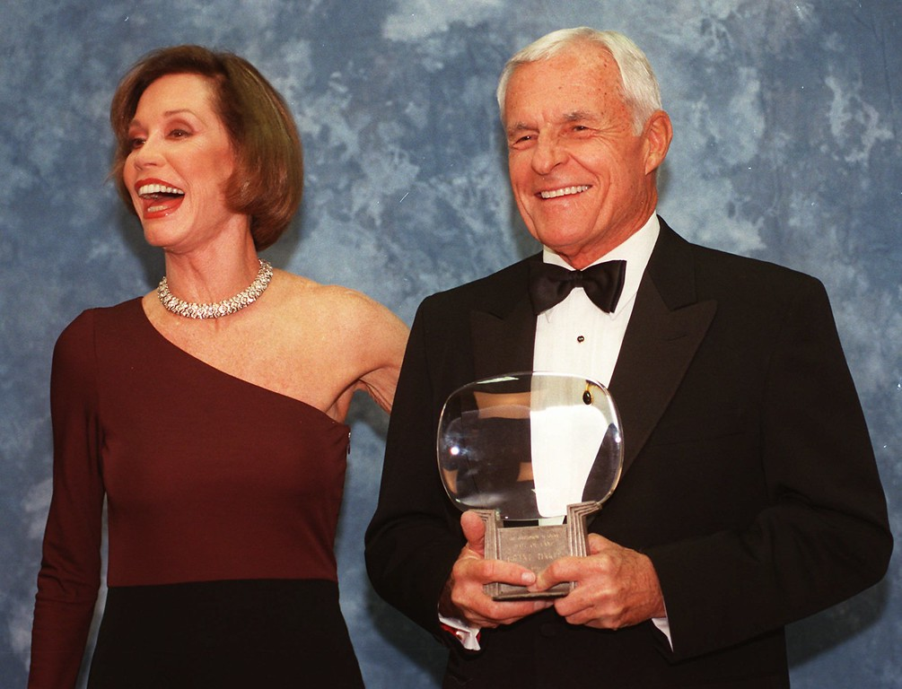 ". Television executive Grant Tinker holds up his Hall of Fame award alongside his ex-wife Mary Tyler Moore, Saturday, Nov. 1, 1997, at the Academy of Television Arts & Sciences\' 13th Annual Hall of Fame induction ceremonies in the North Hollywood section of Los Angeles. Receiving Hall of Fame awards with Tinker were writer/producers James L. Brooks and Garry Marshall, journalist Diane Sawyer and the late producer Quinn Martin. Tinker produced ""The Mary Tyler Moore Show\"" and was married to Moore for 17 years. (AP Photo/Chris Pizzello)"