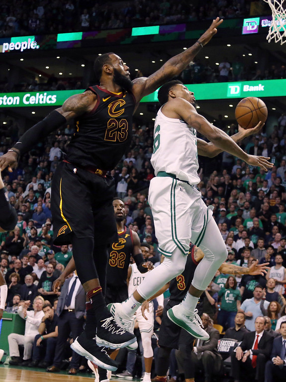 . Boston Celtics guard Marcus Smart, right, drives against Cleveland Cavaliers forward LeBron James during the second half in Game 7 of the NBA basketball Eastern Conference finals, Sunday, May 27, 2018, in Boston. (AP Photo/Elise Amendola)