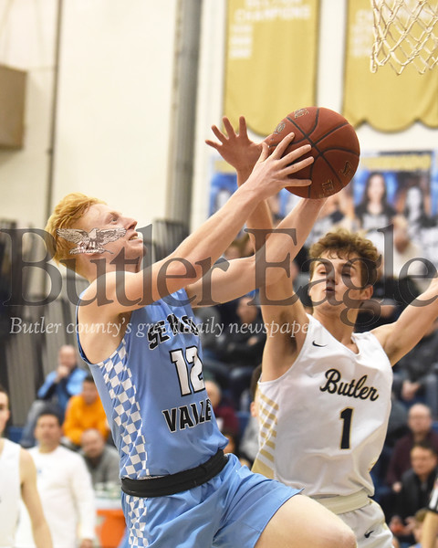 Seneca's Connor Lyczek goes up for a layup against Butler's Raine Gratzmiller in Tuesday's 80-66 loss to the Golden Tornado.